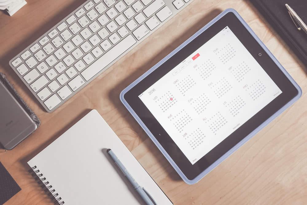 Ipad & Notepad On Desk